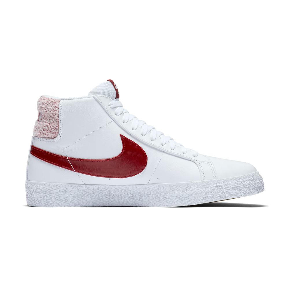 Now in stock the Nike SB Zoom Blazer Mid PRM White Team Red. The Zoom Blazer mid PRM originally introduced in 1972 as a basketball shoe, the Blazer has since transformed into a modern staple for skaters and sneakerheads alike. The Nike SB Zoom Blazer Mid Premium brings ultra-smooth leather construction together with classic design details, for a vintage vibe that works on the court or the concrete. This Blazer has a butter-smooth leather feeling with a varsity vibe and terry cloth heel finish. Productcode: CJ6983101 This Shoe Nike SB Zoom Blazer Mid PRM White Team Red has a White and team red color scheme and has the classical nike swoosh. If ordered now it will be at your door at high speed by fast shipping. Want to find fitting apparel? See Apparel by Nike combine it with other brands in our webshop in the Shoes Apparel Headwear Specials Hardware Accessoires. More info can be found at the online headquarters of Nike SB or Nike. Don't forget to check out our sale page to get lucky. Fier skateshop is based in Dordrecht and is the number one skate shop in the Drechtsteden for shoes, clothing, hardware, service and a big smile when it comes to skateboarding. Also follow us on social media Instagram,Facebook to make sure you're up to date with new products and specials.