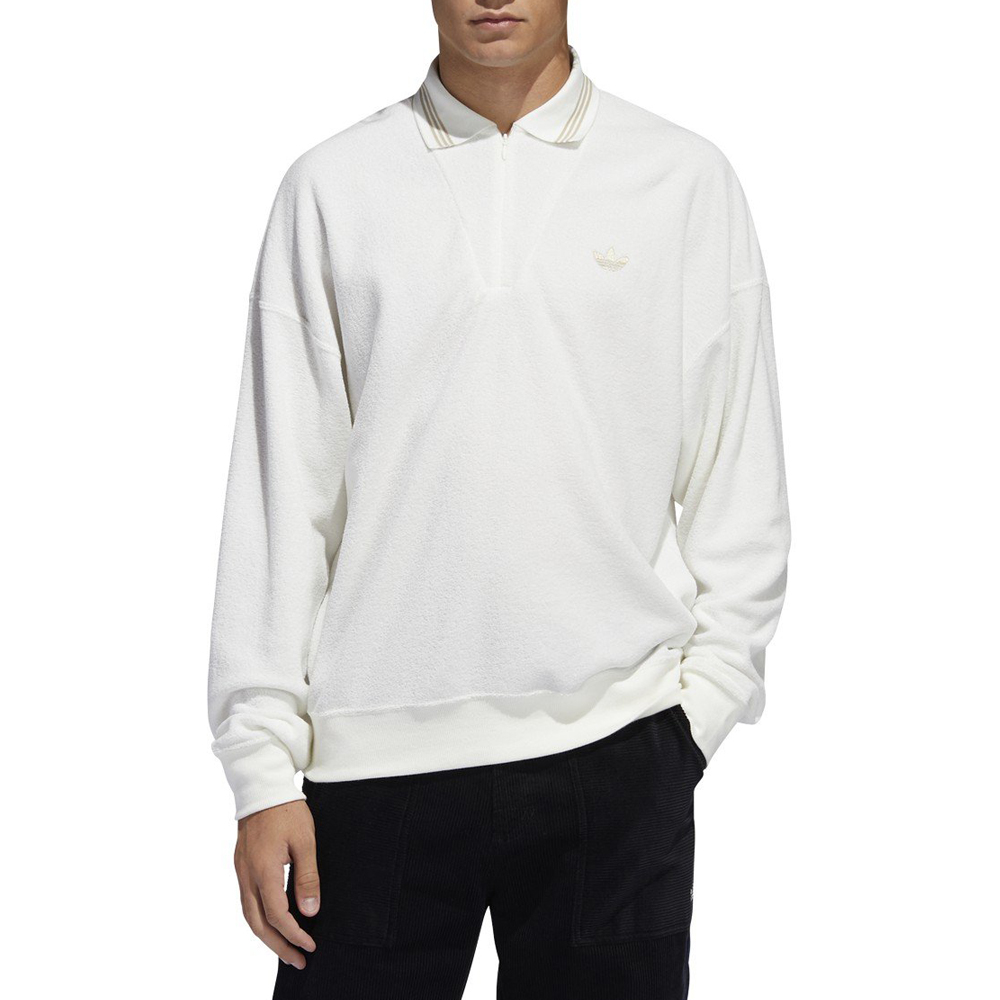 Now in stock Adidas BCL Shirt Long sleeve Long sleeved shirt with polo collar by Adidas, the Adidas BCL Shirt Long sleeve. This Shirt has a wide fit and is made of a mixed synthetic fabric 74% polyester and 26% French Terry Cotton. Subtle zipper can be found from the chest to neck. For the classic look it features a polo collar and ribbed cuffs. Iconic logo embroidery on the left chest and 3 stripe pattern on the collar. Productcode: FM1414 FM1364 Shirt Long Sleeve Polo 74% polyester, 26% cotton French terry Multiple versions
